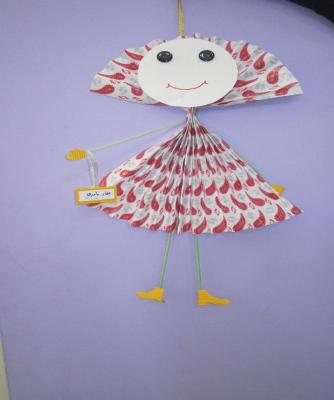 عروسک با کاغذ کادو